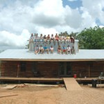 Rural Studio students on roof of Rose Lee's house.