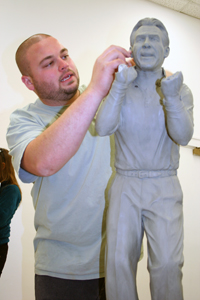 Jeremy K. Davis, undergrad BFA major in art, sculpting the maquette used to cast Coach Saban's statue.