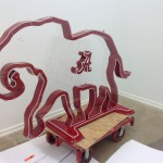"Patrick O'Sullivan and Mike Eddins built the giant plexiglas elephant ""piggy bank"" for Clark Hall. It will hold student donations for scholarships, one dollar at a time."