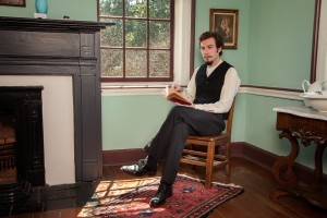 UA student Sam Hardy portrays a 19th century reader in an ART 428 photo shoot. ©2015 Art 428, Department of Art and Art History.