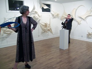 The artist Claire Lewis Evans among her sculptures.
