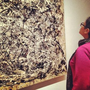 "Dr. Wendy Castenell views Jackson Pollock's painting, ""Number 1A, 1948"" at the Museum of Modern Art in New York."