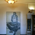 "Bill Dooley measures the space for hanging ""Cassandra"" by Ben Smith"