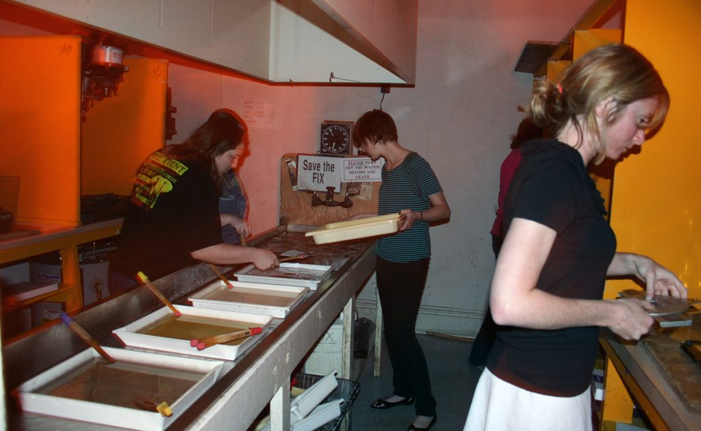 Students in Gay Burke's photo class working in the darkroom.