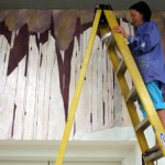 Aynslee Moon painting the walls of the Sella-Granata Art Gallery.