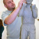 Jeremy K. Davis, undergrad BFA major in art, sculpting the maquette used to cast Coach Saban's statue.
