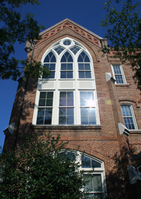 a brick building with Gothic details