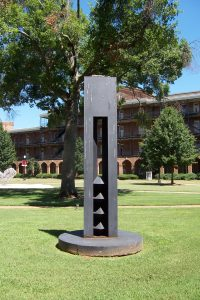 Billy Lee, Homage to Brancusi, 1993, stands in Woods Quad.