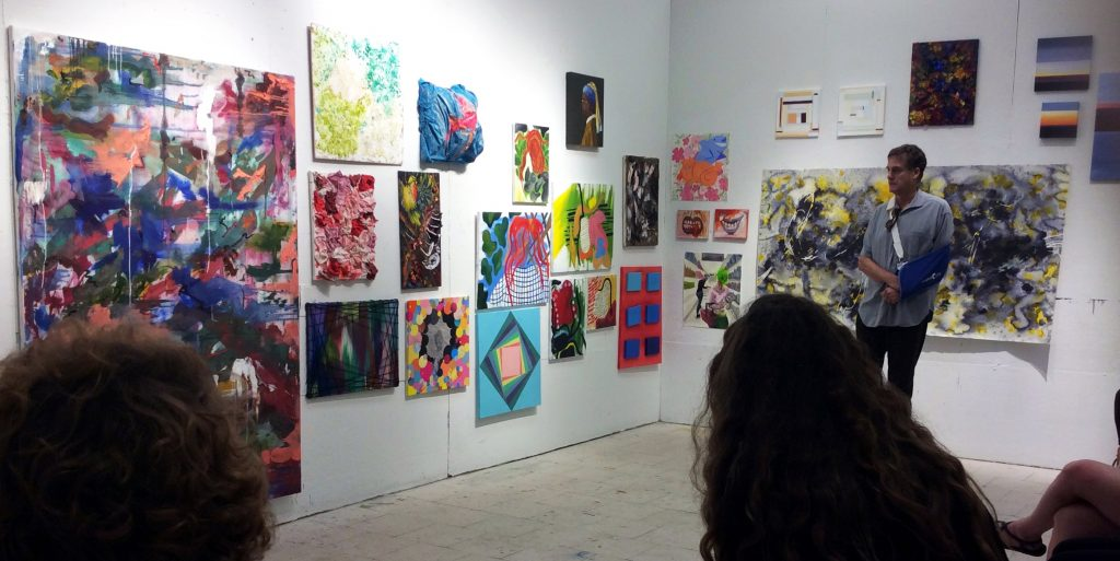 Pinkney Herbert critiques student paintings.