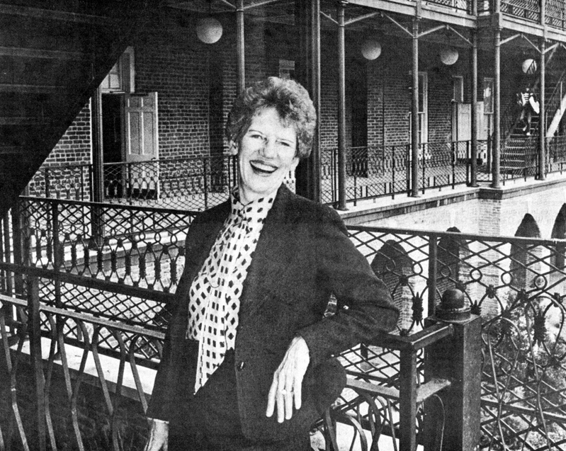 In the spring of 1982, new art department chair Dr. Virginia Rembert poses on the porch of Woods Hall. Photo by Lee Ann Lutz, BFA 1980, and courtesy of the UA College of Arts and Sciences.
