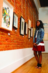 "A UA student views the show ""React"" at the Paul R. Jones Gallery in downtown Tuscaloosa."