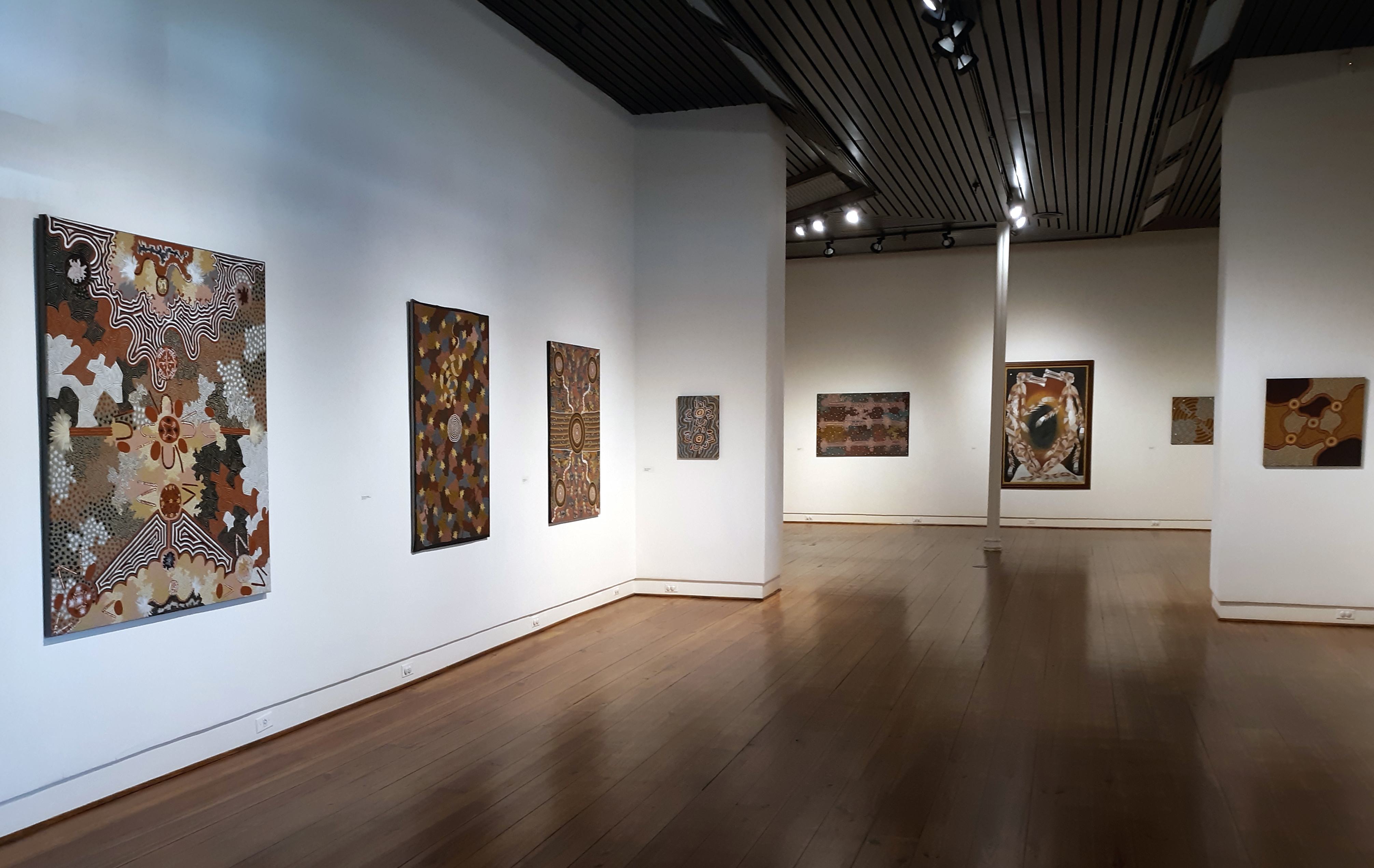 "Installation view of ""Pattern Thinking: Australian Aboriginal Art from the Collection of Tom and Cynthia Schneider,"" in the SMGA which runs October 11 – November 16, 2018"