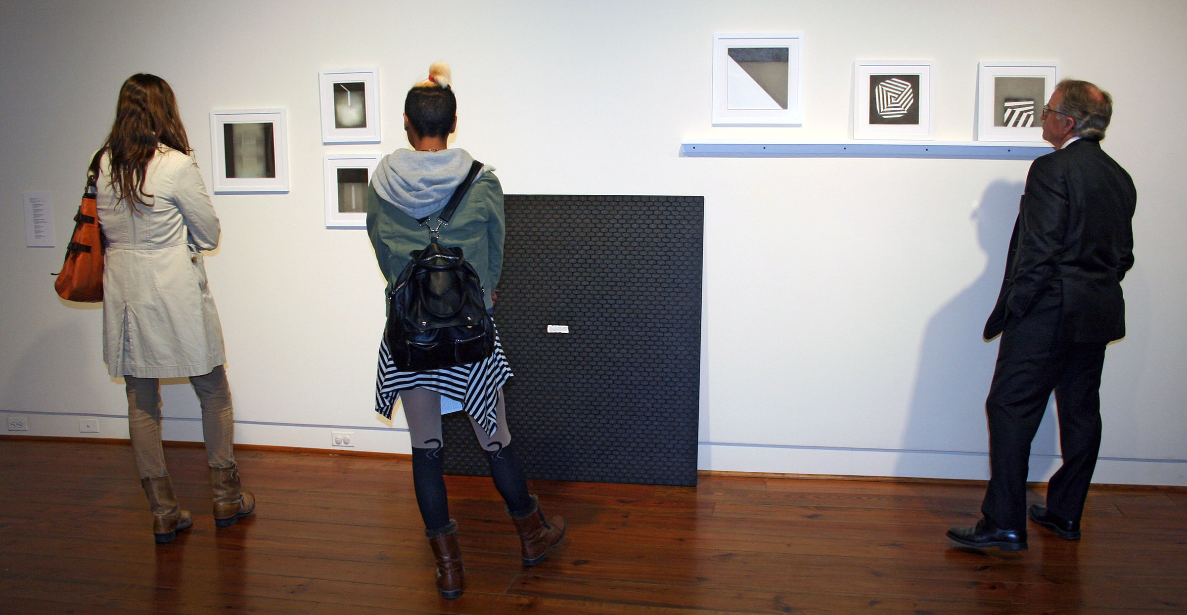 Visitors at the UA Faculty Biennial, Sarah Moody Gallery of Art