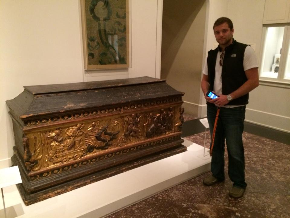 student standing next to a cassone