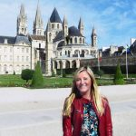 Lauren Eich standing outside St. Etienne church in Caen, France.