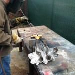 Mike Eddins brazing a cast iron leaf finial from Clark Hall.
