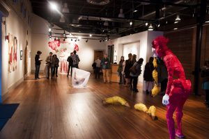 """Ali Jackson, """"Snuffles,"""" in the foreground at the Annual BFA Juried Exhibition"""