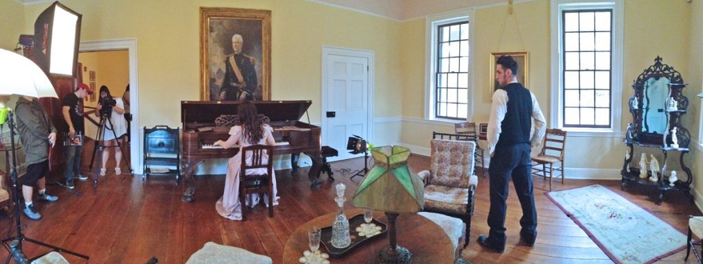 ART 428 students set-up for the photo shoot in the Gorgas House. Major General William Crawford Gorgas is in the portrait on the wall. Photo ©2015 Art 428, Department of Art and Art History.