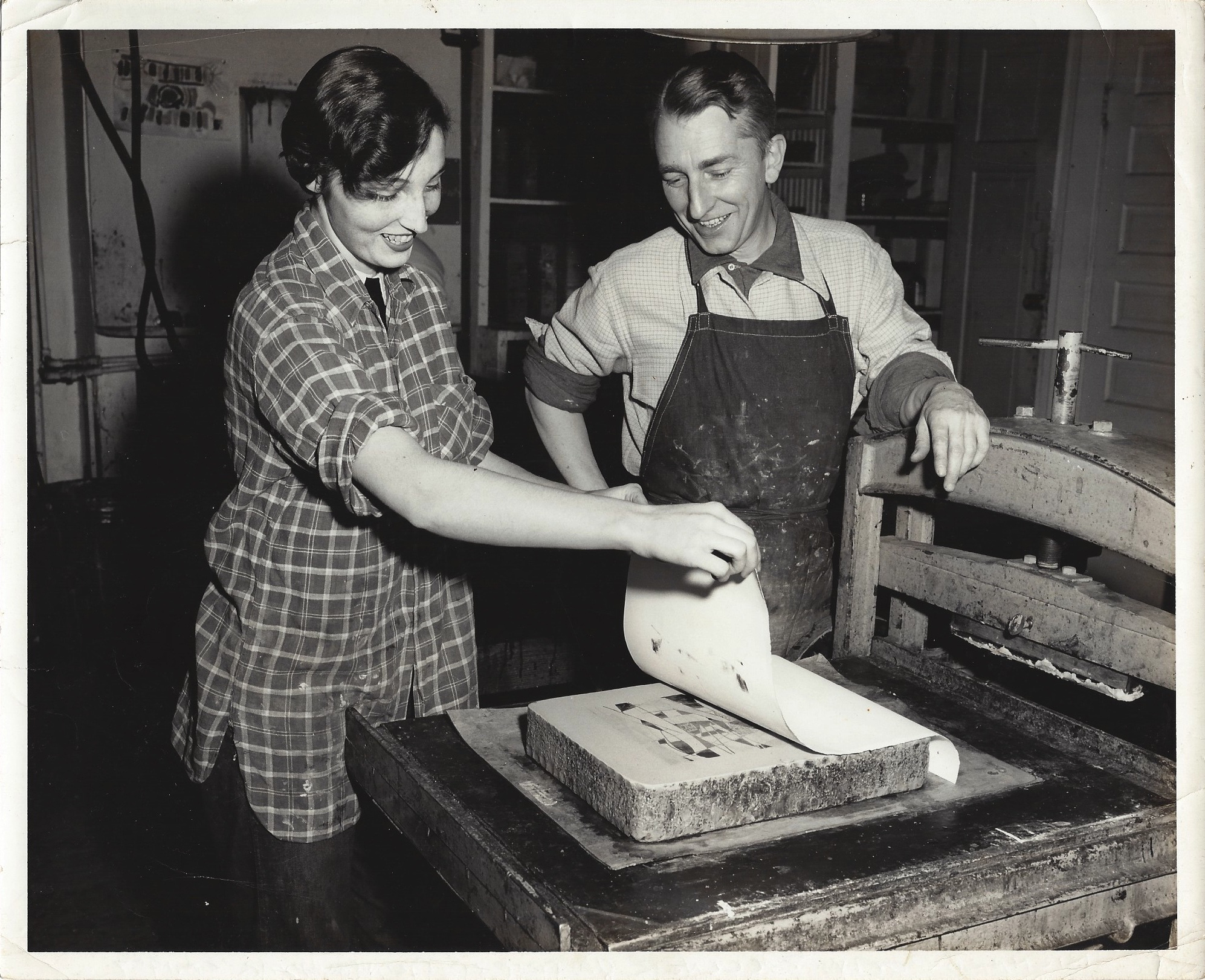 Barbara Pennington proofing a lithograph print with Professor Richard Zoellner.