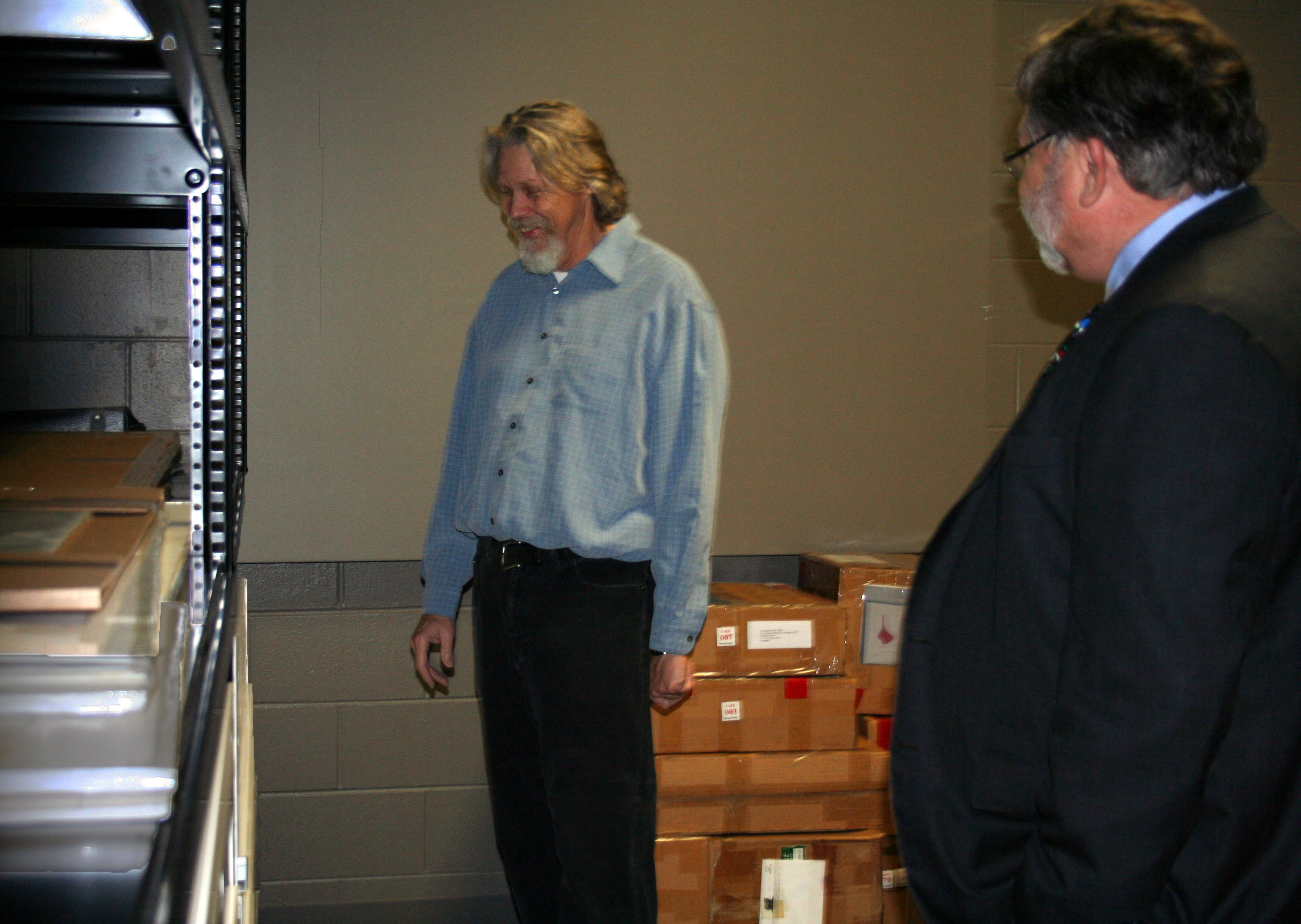 SMGA Director Bill Dooley gives Dean Olin a tour of the new space at the Dean's open house for the new curation space for the Sarah Moody Gallery of Art's Permanent Collection at The University of Alabama.