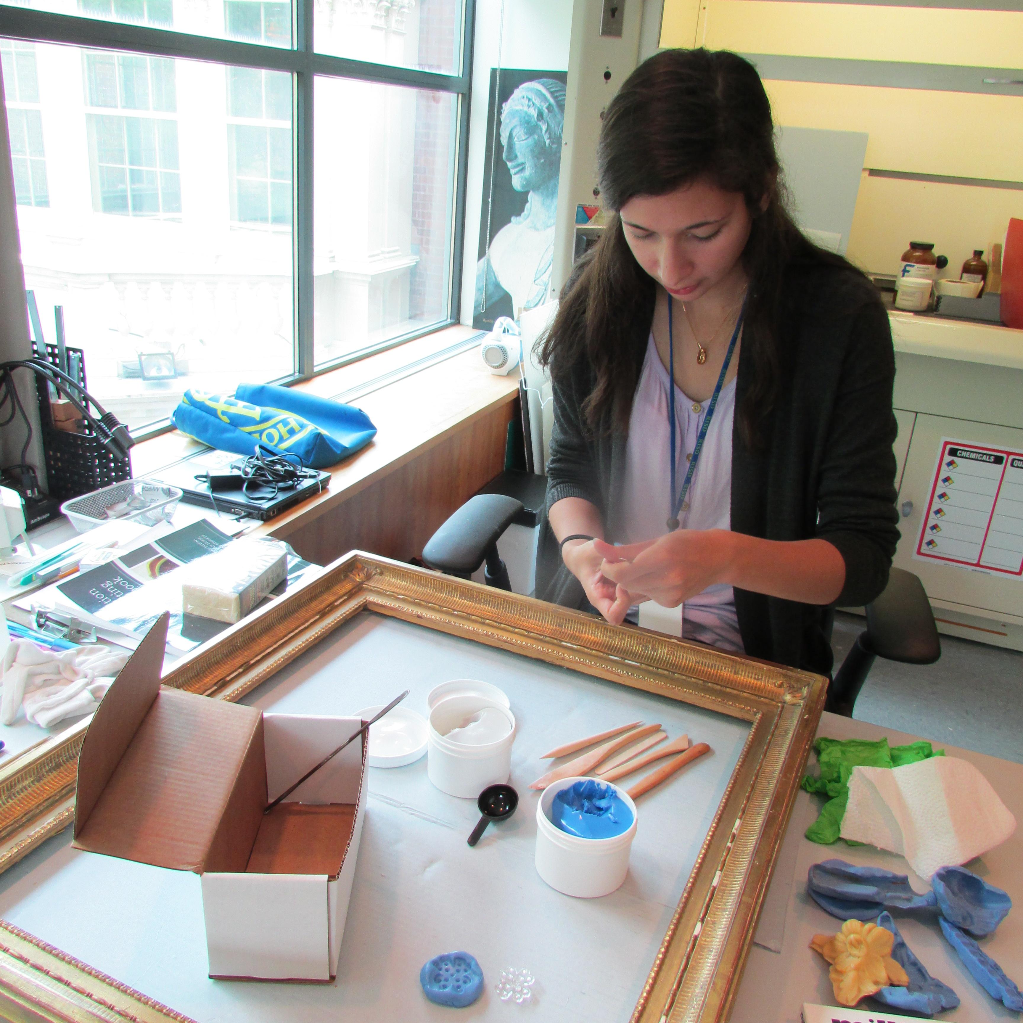 Erin Hein restores a frame during her internship at the RISD Museum Conservation Department.