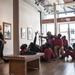 Dr. Lucy Curzon talks with K-12 students from Tuscaloosa City Schools visiting the Paul R. Jones Gallery of Art.