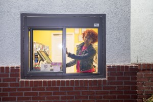 a woman in a drive-through window