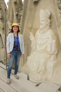 Dr. Jennifer M. Feltman with newly installed sculpture of St. Peter, east end, Yorkminster.