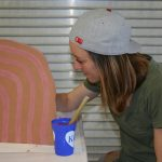 Grad student Sydney Ewerth paints a ceramic piece that will be part of a sculptural installation by artist Amy Pleasant.