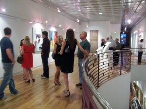 Harrison Galleries in downtown Tuscaloosa during a First Friday gathering.
