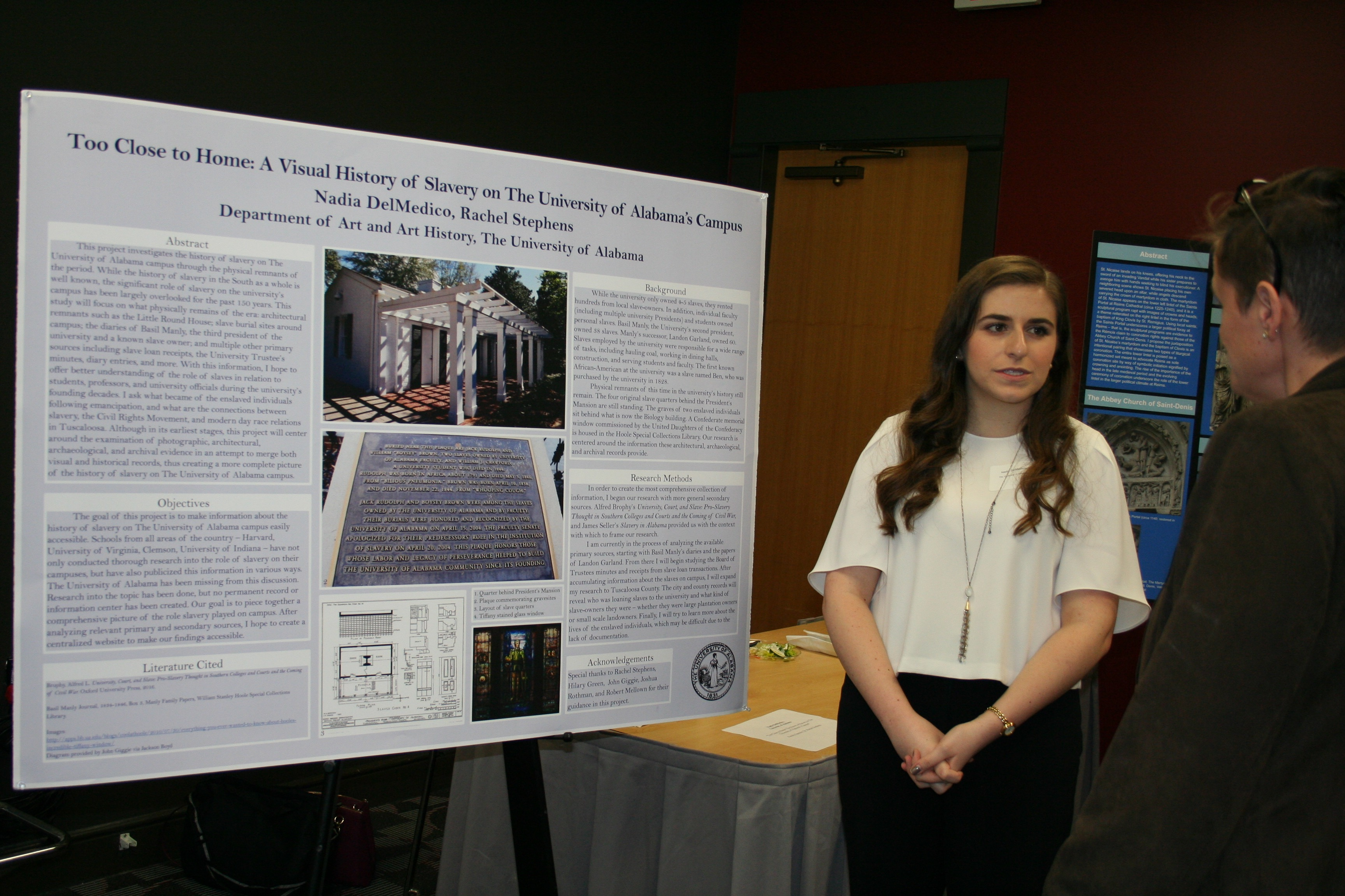 "Nadia DelMedico, with her poster, ""Too Close to Home: The History of Slavery on the University of Alabama Campus."""