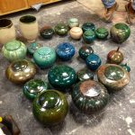 Daniel Livingston with some of his raku pots.