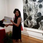 Aislynn Lupien receiving a scholarship award.