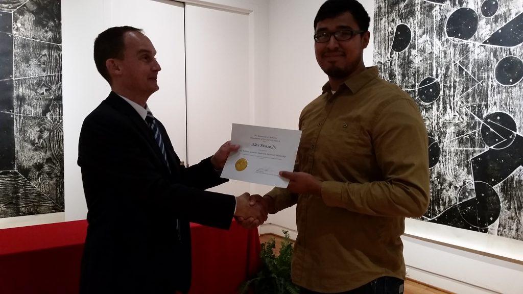 Alex Picazo, Jr. receiving a scholarship award.