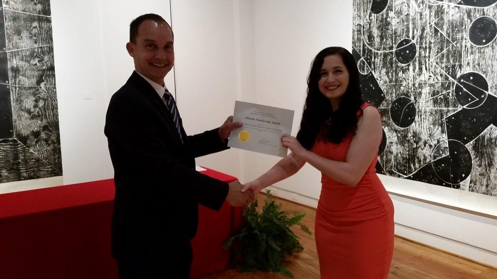 Alyson Katherine Smith receiving a scholarship award.