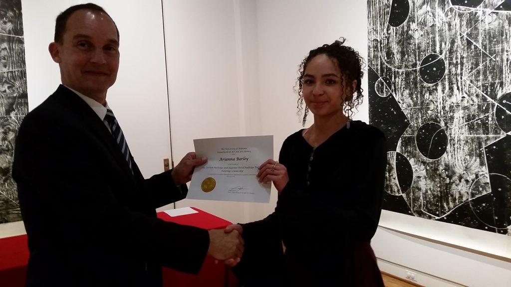 Arianna Barley receiving a scholarship award.