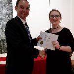 Bailey Smith receiving a scholarship award.