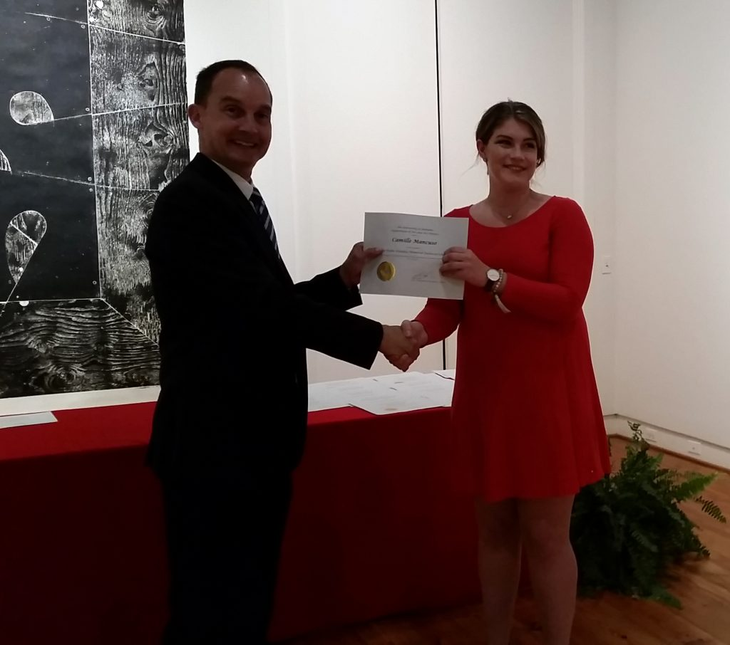 Camille Mancuso receiving a scholarship award.