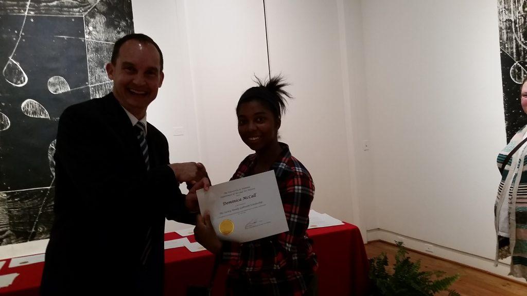 Deminica McCall receiving a scholarship award.