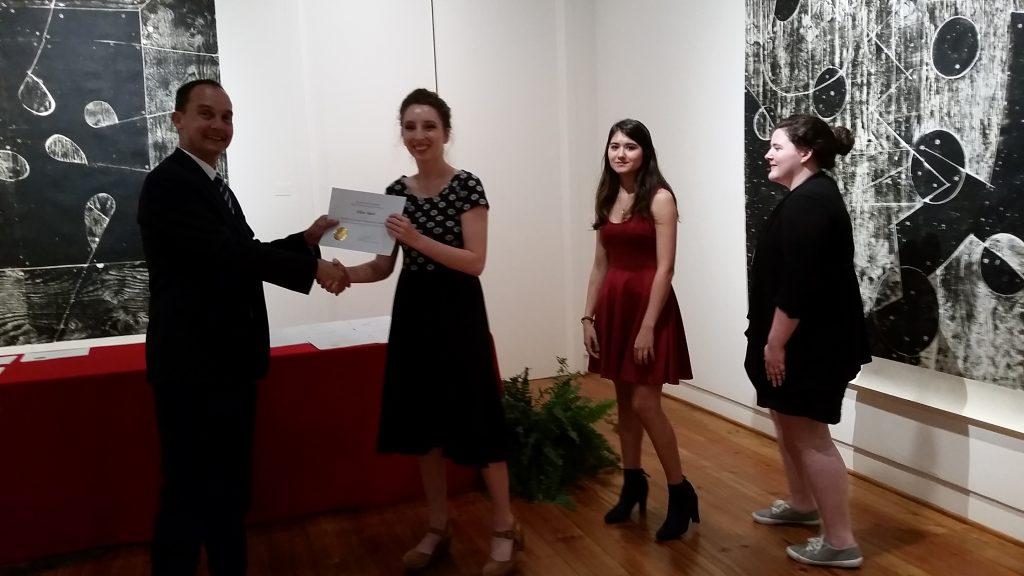 Ellen Hart receiving a scholarship award.