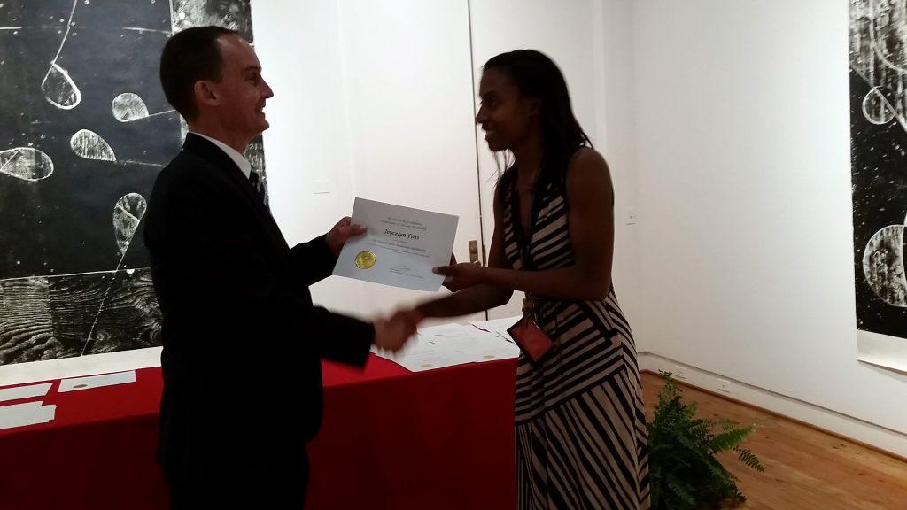 Joycelyn Fitts receiving a scholarship award.