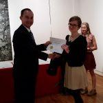 Kalypso Homan receiving a scholarship award.