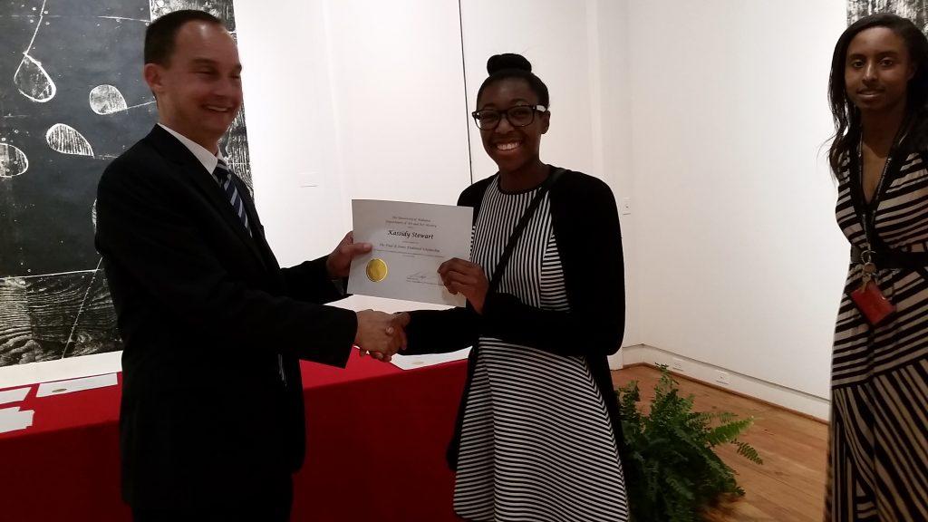 Kassidy Stewart receiving a scholarship award.
