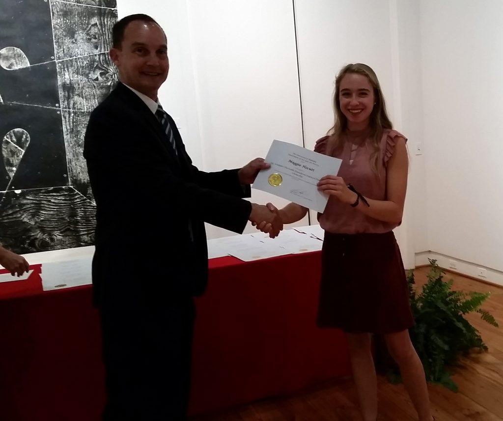 Maggie Hocutt receiving a scholarship award.