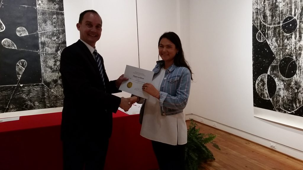 Megan Goldman receiving a scholarship award.