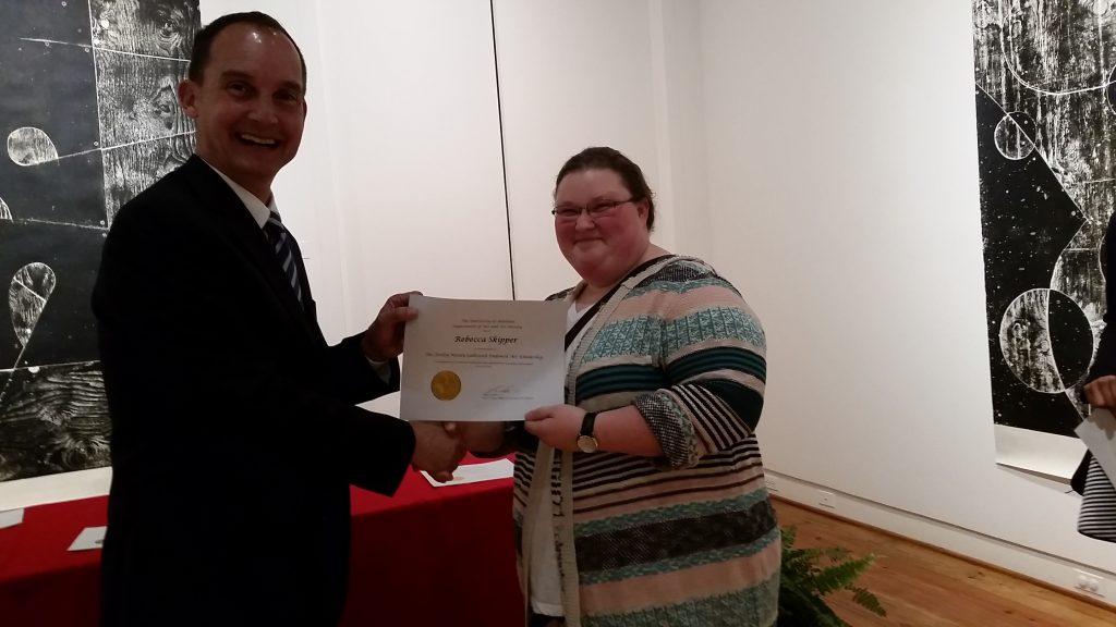 Rebecca Skipper receiving a scholarship award