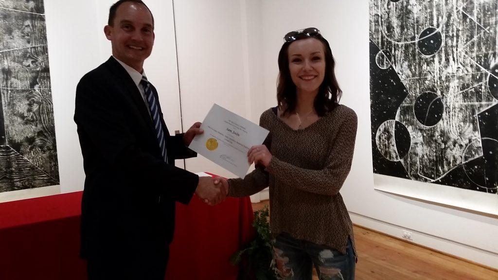 Samantha Joslin receiving a scholarship award.