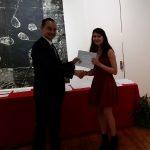 Anna Sella receiving a scholarship award.