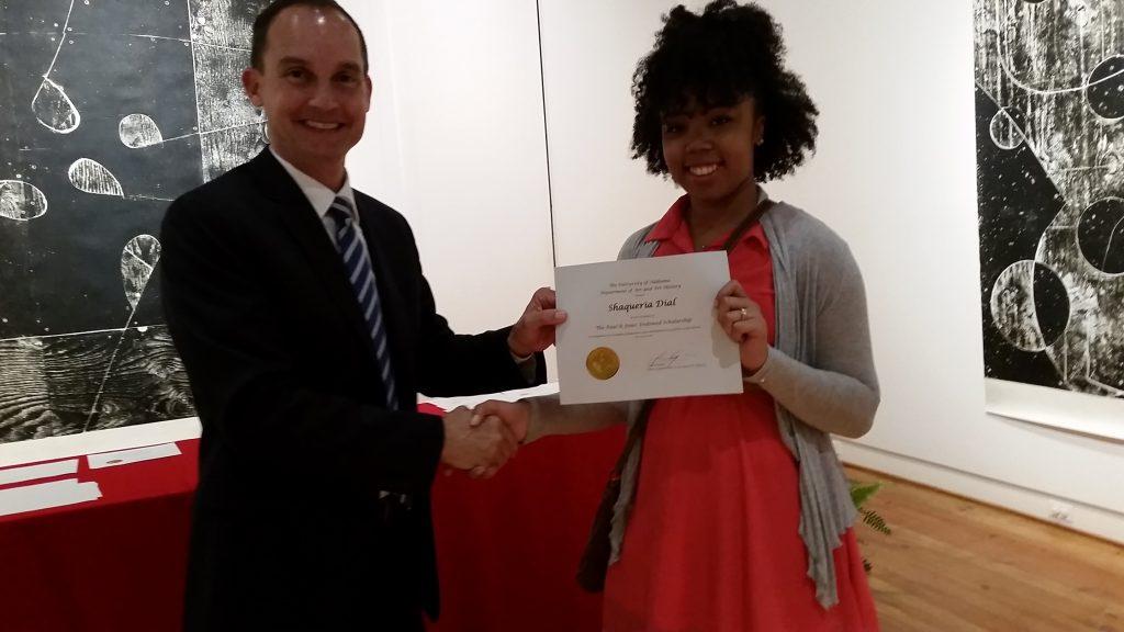 Shaqueria Dial receiving a scholarship award