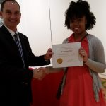 Shaqueria Dial receiving a scholarship award